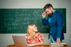 Nerd funny student preparing for university exams. Students campus education knowledge concept. Bearded tutor helping. His student. Preparing for exam in royalty free stock images