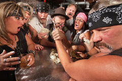 Nerd and Gang Arm Wrestling Royalty Free Stock Images