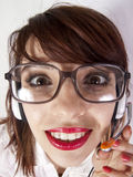 Nerd girl in call center Royalty Free Stock Photo
