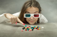 Nerd girl with 3d glasses indicated candy. Finger pointing royalty free stock image