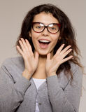 Nerd girl in glasses and with brackets on teeth. Positive, excel stock photo