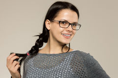 Nerd girl in glasses and brackets on teeth. Positive, excellent student woman hipster. Royalty Free Stock Photography