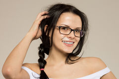 Nerd girl in glasses and  brackets on teeth. Positive, excellent student woman hipster. Stock Image