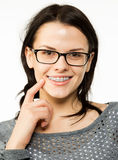 Nerd girl in glasses and brackets on teeth. Positive, excellent student woman hipster. Royalty Free Stock Image