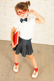 Nerd girl holding a red book Royalty Free Stock Photo