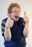 Nerd giving energetic thumbs up. A weird nerd is enthusiastically gesturing  a thumbs up Royalty Free Stock Photos