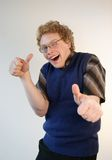 Nerd giving energetic thumbs up. A weird nerd is enthusiastically gesturing  a thumbs up Royalty Free Stock Photography
