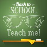 Nerd glasses on the chalkboard with back to school. Greeting Royalty Free Stock Photography