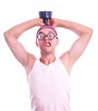 Nerd in glasses with dumbbell trains Royalty Free Stock Photo