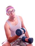 Nerd in glasses with dumbbell trains Royalty Free Stock Images