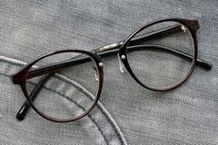 Nerd glasses. Nerd glasses isolated on blue jeans background royalty free stock photography