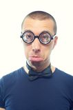 Nerd in glasses. Portrait of young nerd in glasses and bow tie Royalty Free Stock Photography