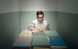Nerd guy at desk Royalty Free Stock Photos