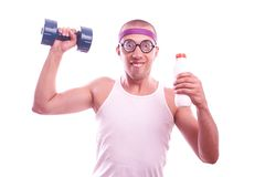 Nerd guy with dumbbell and bottle Stock Images