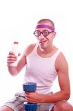 Nerd guy with dumbbell and bottle Stock Photo