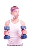Nerd guy with dumbbells Stock Images