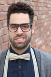 Nerd Guy With Glasses, Bow Tie, and Brick Wall Background Royalty Free Stock Image