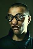 Nerd guy in glasses. Portrait of nerd guy in glasses stock photo