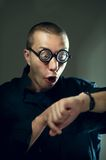 Nerd guy looking at watches Royalty Free Stock Photo