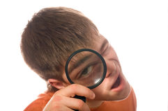 Nerd guy with magnifying glass. (shallow dof royalty free stock photography