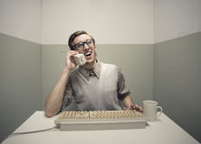 Nerd guy on the phone Royalty Free Stock Images