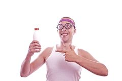 Nerd guy showing with finger on bottle Royalty Free Stock Photography