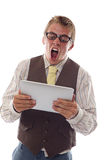 Nerd with his tablet Royalty Free Stock Photography