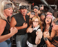 Nerd Holds Up Fists with Gang in Bar Royalty Free Stock Image