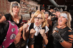 Nerd with Hostile Biker in Bar. Motorcycle gang members force a fight with nerd in bar stock photo