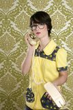 Nerd housewife retro woman talking vintage phone. Nerd housewife retro woman dial vintage wired phone 70s wallpaper Royalty Free Stock Photography