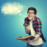 Nerd with an idea. On a blue background holding a book and magnifying glass and by his head was cloud in the shape of speech bubble. Cloud is not real, it's Stock Photos