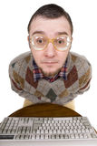 Nerd with keyboard Royalty Free Stock Images