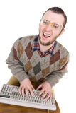 Nerd with keyboard Royalty Free Stock Photography