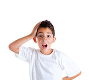 Nerd kid with glasses and silly expression Royalty Free Stock Images