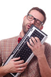 Nerd in love with his keyboard Stock Image