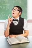Nerd male student. Nerd Chinese male student in the classroom doing stupid pose Royalty Free Stock Photo