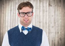 Nerd man in blue vest against blurry wood panel Royalty Free Stock Photos