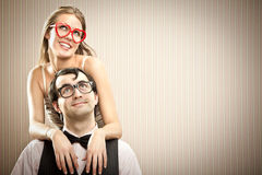 Nerd man boyfriend with his girlfriend love portrait. Nerd men boyfriend with his girlfriend love portrait royalty free stock photos