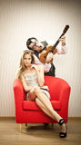 Nerd man boyfriend play ukulele love song for his girlfriend for valentine day Royalty Free Stock Images