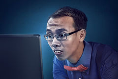 Nerd man concentration using laptop Stock Photo