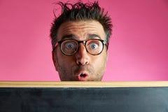 Nerd man crazy behind blackboard funny gesture Stock Image