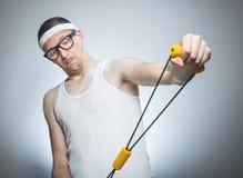 Nerd man doing gym royalty free stock photography