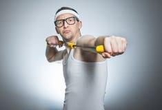 Nerd man doing gym stock photo