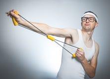 Nerd man doing gym Stock Image