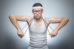 Nerd man doing gym stock images