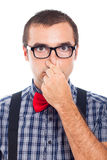 Nerd man holding nose. Close up of funny nerd man holding his nose, isolated on white background Stock Photography