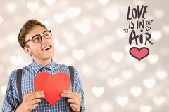 Nerd man holding pink heart with I love u message Stock Photos