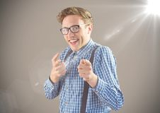 Nerd man pointing against brown background with flare Stock Photo