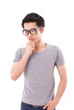 Nerd man thinking, studio shot, white background Stock Photography