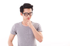 Nerd man thinking, studio shot, white background Royalty Free Stock Image